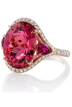 {Ring with 10.08 ct. oval pink tourmaline, 1.1 cts. t.w. pear-shape rubies, and 0.56 ct. t.w. diamonds in 18k rose gold by Omi Privé,}