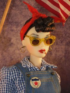 """The Studio Commissary: We Can Do It!....(3 PICS)  - Posted by Megin in Portland on July 2, 2017, 9:04 am.  New to my patriotic collection this year are these Rosie the Riveter outfits! Ivy wears a recent ebay find made by an unknown artist. It's """"old school""""....the shoes are handmade, which was done a lot in the glory years of Gene. The doll (the outfit was on a Blue Goddess) also came with the monogramed bucket (full of bolts!), flag and copies of actual catalogue pages showing the 1940's…"""