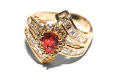 #200-10070 - LADIES 18 KARAT YELLOW GOLD RING WITH A .87 CARAT PEAR CUT RUBY, 1.22 CARATS OF BAGUETTE CUT DIMOANDS & .25 CARATS OF ROUND CUT DIAMONDS (VVS QUALITY). PLEASE CONTACT STADLER'S FOR MORE INFORMATION