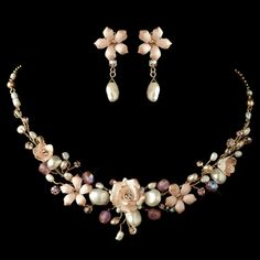 "This gorgeous pink porcelain flower necklace and earring set is all the rave for weddings. The rich gold or silver plating with the beautiful warm colors and Freshwater Pearl accents are a beautiful combination to wear on your wedding day, for your bridesmaids or any special occasion.Earrings Measure 1 3/4"" long Necklace Measure 15-17"" long"