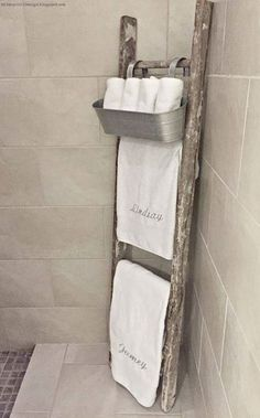 Master Bathroom. Old rustic ladder used as towel rack with galvanized hanging bucket for wash cloths. Great Design Idea