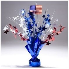 get these from the dollar tree and add the flags for table decor?
