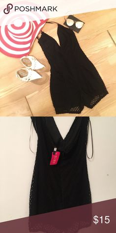 Black Quilted Romper Black Romper with zipper in the back. Tags say Medium but fits like a smalll. Pants Jumpsuits & Rompers