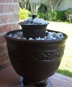 DIY Fountain - LOVE THIS ONE - LOOK AND INSTRUCTIONS FOR FRONT DECK. ONE ON EACH SIDE OF THE STAIRS. WILL USE PAVERS UNDERNEATH INSTEAD OF WOOD BALLS.