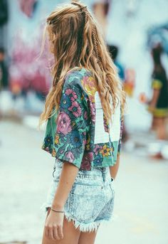 I would cover white square on her back with fabric flowers. Very cute tee fabric pattern.
