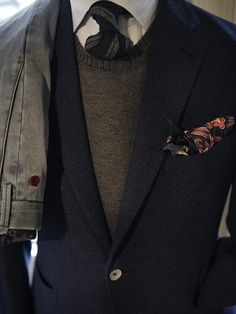 Suit jacket over a crew neck sweater, Oxford button down and tie. Love this look.