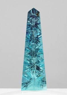 The largest Aquamarine in the world, called Dom Pedro, is 14 inches tall and weighs 10,363 carats. That's the heft of a barbell, nearly five pounds. / Smithsonian National Museum