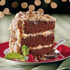 Chocolate Velvet Cake With Coconut-Pecan Frosting | A lavish amount of melted chocolate and sour cream gives these moist cake layers a tender, velvet-textured crumb.