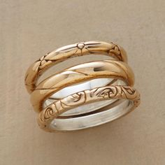 BASKING IN BRONZE RING TRIO--Each from this bronze band ring trio is cast with a distinctly different pattern, the incised designs making a compatible threesome. Bronze bands lined with sterling silver. Set of 3 in whole sizes 5 to 9.