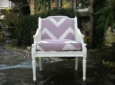 Cane chair refinished with purple zig zag fabric.