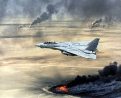 US Navy F-14A Tomcat flies over burning Kkuwaiti during Operation Desert Storm.