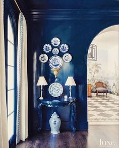 luxe Navy blue lacquered walls, ceiling, and trim are the perfect backdrop for blue and white Chinese porcelain.