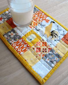 I'm in love with these colors!   a scrappy mug rug by Angela - Fussy Cut, via Flickr