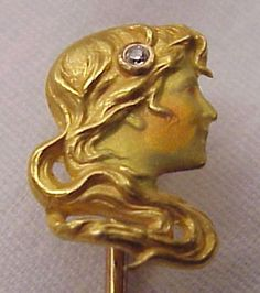 This circa 1900, profile of the lady is pure Art Nouveau with her lovely dimensional swirling hair