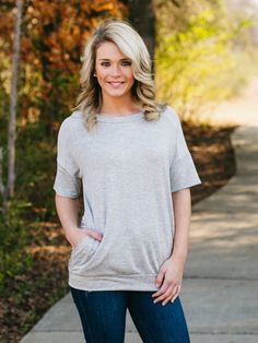 This dolman top is the perfect updated basic. Soft and stretchy material, scoop neckline, shoulder contrast and pockets. This style is flattering on any body type and perfect for throwing on when you'