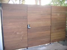 IPE wood gate with steel frame and push button combination lock. (Before stain)