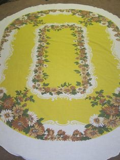 Yellow table cloth with brown and blue by withintheheart on Etsy, $11.99