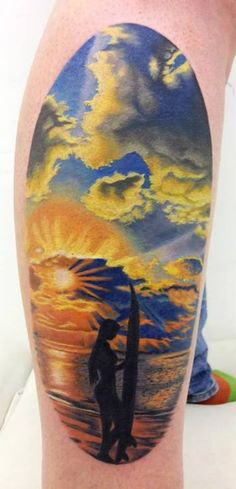 Surfers enjoy beach tattoos. By Jennifer Sterry.