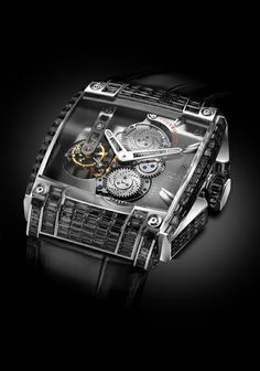 REB-5 Tourbillon Black Diamond. SOLD OUT! The REB-5 features a mechanical tour billion movement and twin mainspring barrels to provide seven days of power.  For more information, please visit: http://www.rebellion-timepieces.com/collection-reb-5-tourbillon-manufacture.php#1