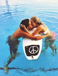 Kiss on a surf board