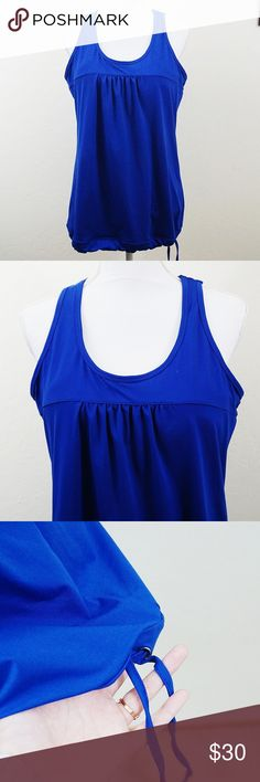 Athleta XL Royal Blue Tie Bottom Sports Top Athleta XL Royal Blue Tie Bottom Sports Top. Great condition. No rips or stains. Built in Sports Bra. Bright color. No fading. Perfect for any sport.  Length 25in Chest Flatlay 16in 11oz #21  Offers Welcome Bundle for a Discount Ships 1-3 days Athleta Tops Tank Tops