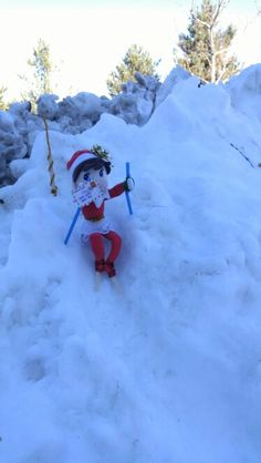 Elf on the shelf ski run - popsicle sticks for skis and straws as the ski poles.  All held on with pipe cleaners.  Used a tent stake to hold the elf up.
