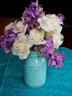 painted jar....floral arrangement made with dollar store silk flowers for DIL's bridal shower