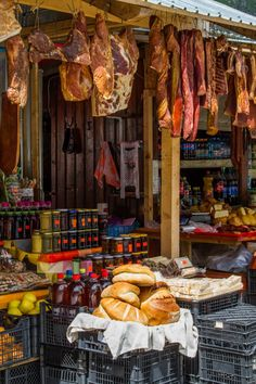 A vendor selling traditional meats, cheese, and other wonderful food items located in the pass of the Transfagarsan Highway.  Cutting across Transylvania, you will want to put this road trip on your Romania travel itinerary.  Click through to find out more. ~ReflectionsEnroute