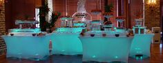 Lighted Buffet tables with spandex linens and Ice Serving pieces