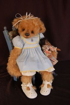 Sweet little Sarah Beth is made out of a distressed mohair and is wearing a vintage doll dress.