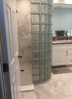 Walk in glass block shower wall with a low profile solid surface shower pan   Innovate Building Solutions