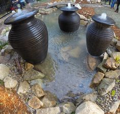 Bubbling Fountain urns installed in Pond