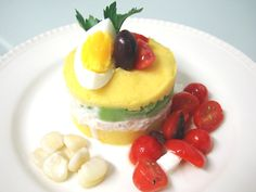 Causa limeña. Potatoes, lime juice, avocado, tuna... bursting with flavor.