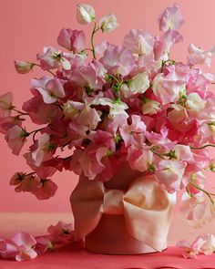 All an overflowing vase of sweet peas needs to become an amazing centerpiece is a perky bow.