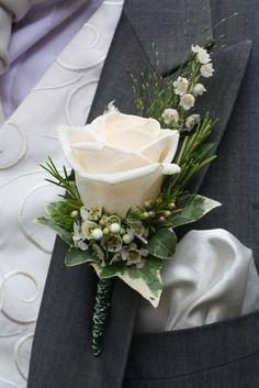 The Bride Groom's special Boutonniere of a Vendella Rose with Lily of the Valley, Rosemary and White Wax Flower Blossom Our gorgeous Brid...
