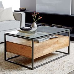 Made from richly-grained raw mango wood, our Box Frame Storage Coffee Table offers plenty of room for books, magazines and knick-knacks with its glass top and open shelf. We also gave it two roomy drawers to keep remotes within reach but out of sight.