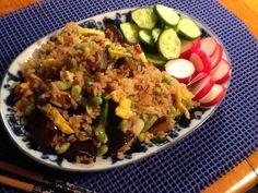 Dinner of eggplant fried rice and sliced fresh raw veggies