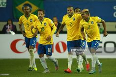 Douglas Costa (R) of Brazil celebrates with teammates after scoring the second goal of his team during the 2015 Copa America Chile Group C match between Brazil and Peru at Municipal Bicentenario Germán Becker Stadium on June 14, 2015 in Temuco, Chile.