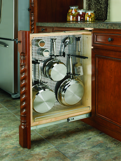 Rev-A-Shelf's 434-BF-6SS Stainless Steel Panel Pullout Organizer features full-extension ball bearing slides, black accessory hooks, pegs, and magnetic grade stainless steel panel that provide endless storage customization for storing pots and pans, cleaning accessories, various cooking utensils, keys, craft supplies and much, much more.