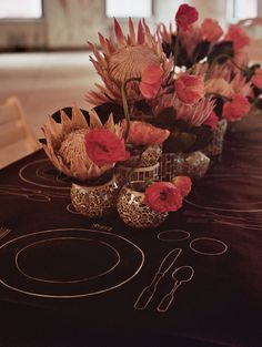 eclectic centerpiece runner with king protea and poppies // photo by Tory Williams // flowers by Celadon & Celery