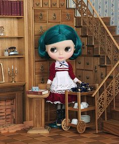 Incredibly detailed woodwork staircase. (beautiful Blythe doll too)