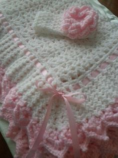 """A gift baby blanket. From """"Keepsake Baby Afghans"""" book by Kay Meadors. This pattern is called heirloom ruffles. I really liked the way it turned out. I made the headband """"on the fly"""" using you tube as a guide."""