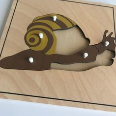 Snail Puzzle one of a series of wooden puzzles whose pieces illustrate the component parts of the different vertebrate groups. Perfect for small hands. Local Map, Montessori Materials, Vertebrates, Wooden Puzzles, Zoology, Puzzle Pieces, Kids House, Snail