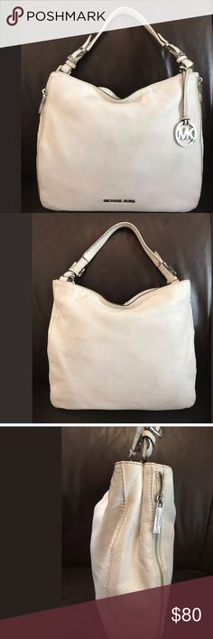 """Auth Michael Kors Large Pebbled Leather handbag I'm offering a beautiful Authentic Michael Kors White Pebbled Leather Large Shoulder Handbag in great condition with little normal wear onlyhas little wear on corners, barely noticeable.   It measures 12"""".x 12"""" x 3"""" and has 2 outside zippers for discreet storage, very unique, see photos. The interior is very clean as well, see pics with liner turned inside out, has lots of room, key Clip and compartments to stay organized. The handle is…"""