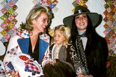 Cher at an event with her mother and daughter, Chastity, 1974.