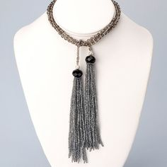 Czech glass and silver fringe long lariat necklace with glass jet black faceted beads and silver fringe. This luxurious necklace measures 48 inches