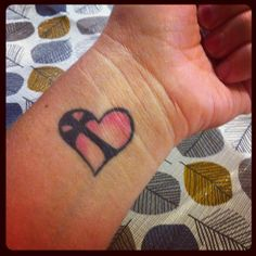 Wrist tattoo, heart with cross inside. A reminder to always keep God in your heart