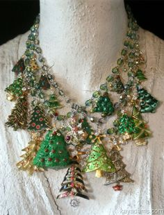 What a clever idea! Old tree pins into a necklace:many is more