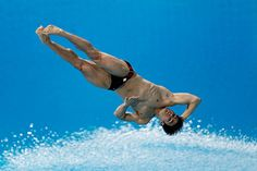 Alexandre Despatie of Canada dives during the men's 3m springboard semi-final in the FINA Diving World Series in Dubai, United Arab Emirates.