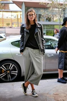 sneakers and pearls, street style, grey culottes, black tee and black leather jacket, black converse, trending now